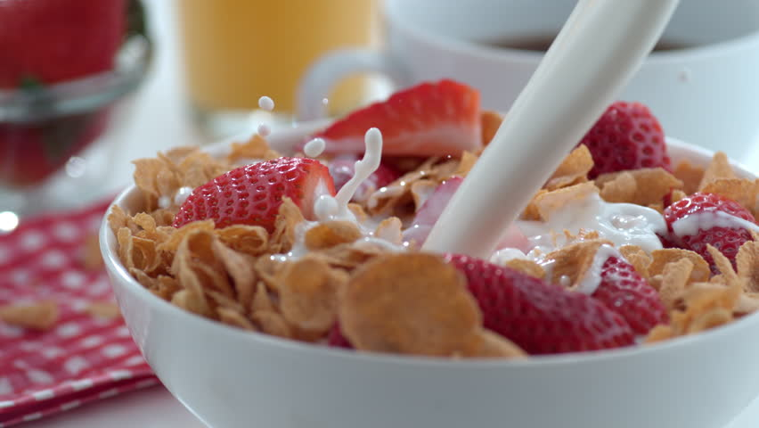 Milk pouring into cereal bowl in slow motion; shot on Phantom Flex 4K at 1000 fps #8987134