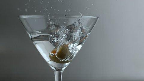 Slow motion shot of olive splashing into martini; shot on Phantom Flex 4K at 1000 fps