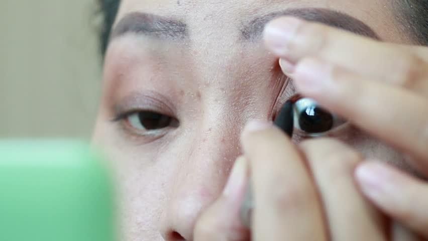 Asian women Draw the edge of eyelid  A part of makeup,Thailand, 1920x1080   Shutterstock HD Video #9050461