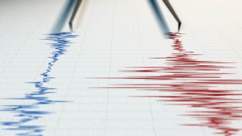 Close view of a seismograph with two arrows drawing with red and blue ink.
