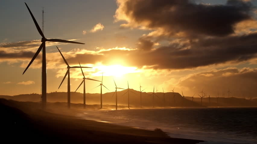 Wind turbine power generators silhouettes at stormy ocean coastline at sunset. Alternative renewable energy production in Philippines | Shutterstock HD Video #9085166