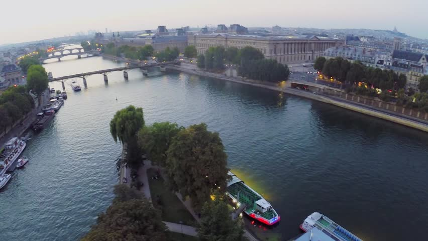 City traffic near Royal Palace on shore of Seine river at autumn evening in Paris. Aerial view | Shutterstock HD Video #9147932