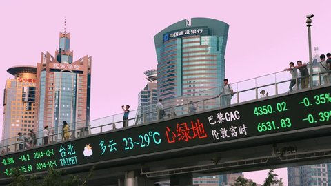 SHANGHAI, CHINA - OCTOBER 4, 2014: Financial electronic Dow Jones index billboard on October 4, 2014 in Shanghai, China, 4K, UHD,