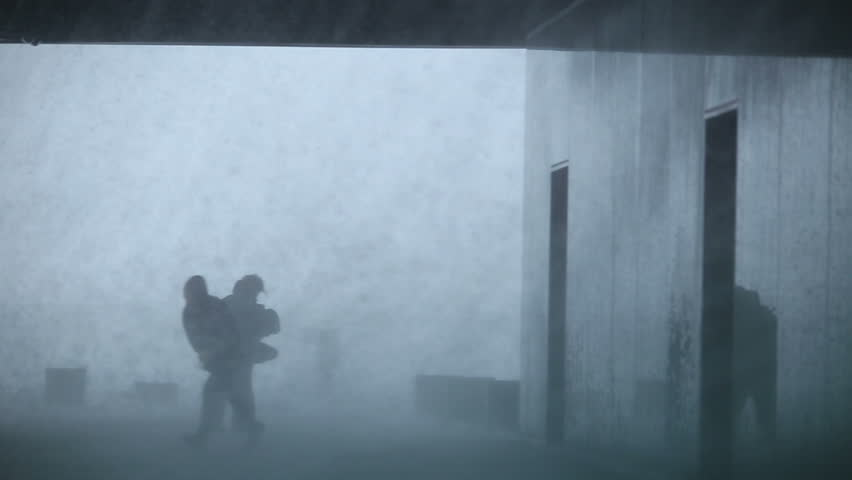 People struggling inside a building during gale force extreme weather rain storm blizzard, Reykjavik, Iceland