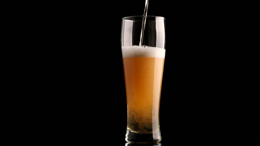 Beer poured in glass on black background | Shutterstock HD Video #916681