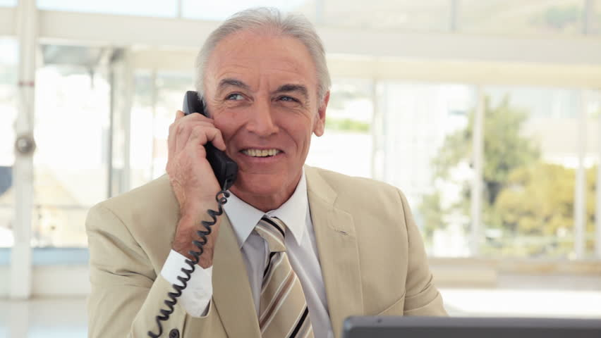 Mature Businessman Answers the Phone