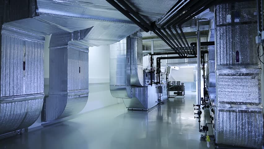 Industrial air ducts of a ventilation system on clean and light technical floor