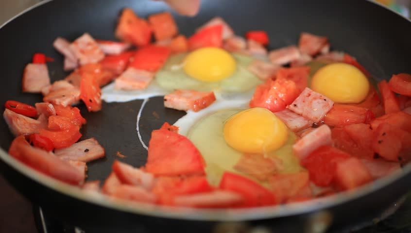 Preparing breakfast with ham tomato hot pepper and eggs timelapse visually similar forumfinder Image collections