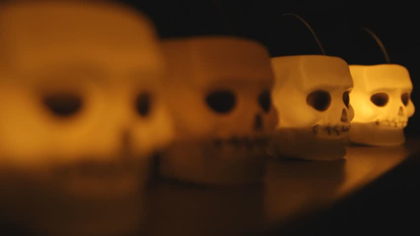 Glowing skull candle from side