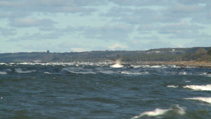 Big waves crash into the coast during a hurricane