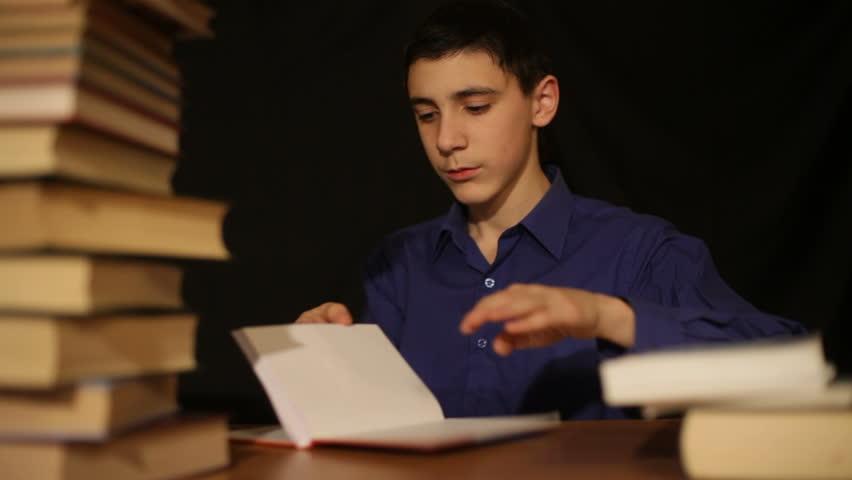 boy flips through books