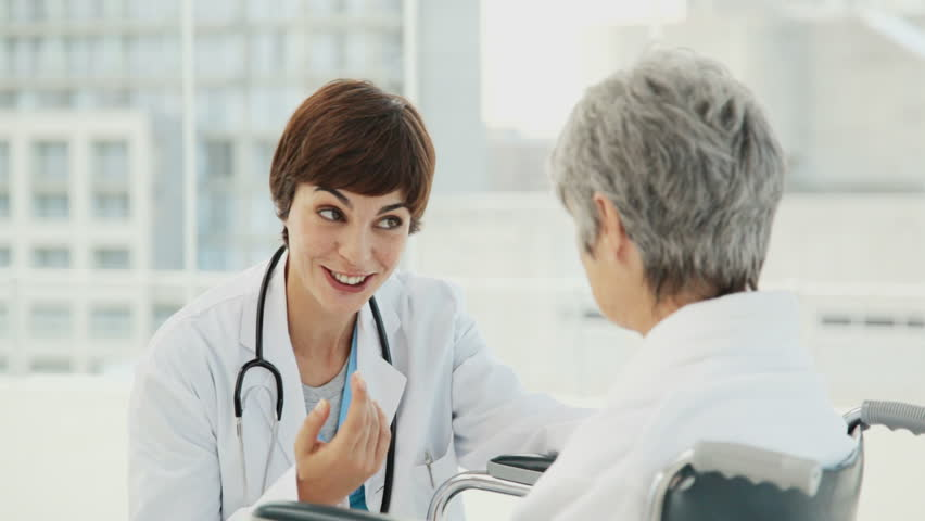 Doctor Consults with her Elderly Patient
