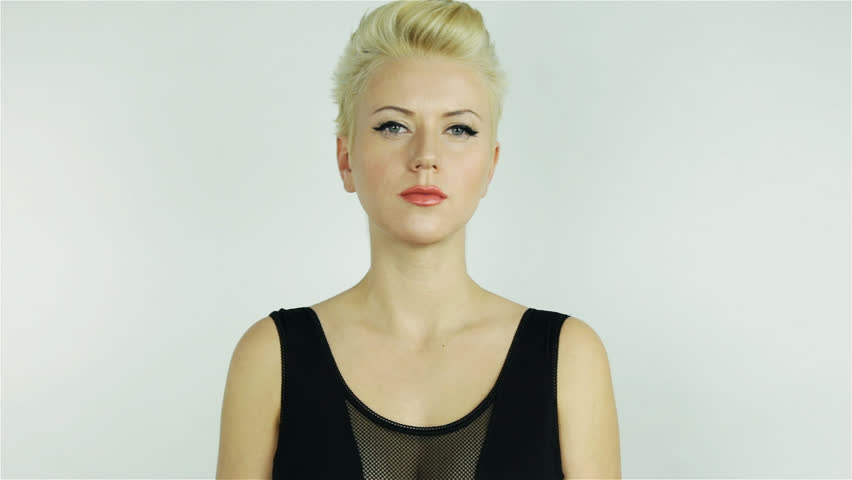 b73240274 hd00 09Beautiful young blonde girl with short hair wearing a black ...