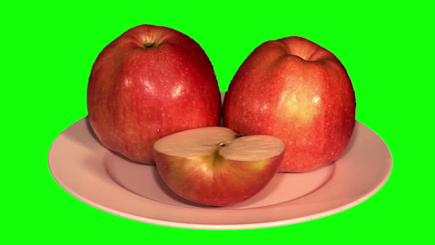2 apples and half on plate rotating on green screen, loop | Shutterstock HD Video #9271979