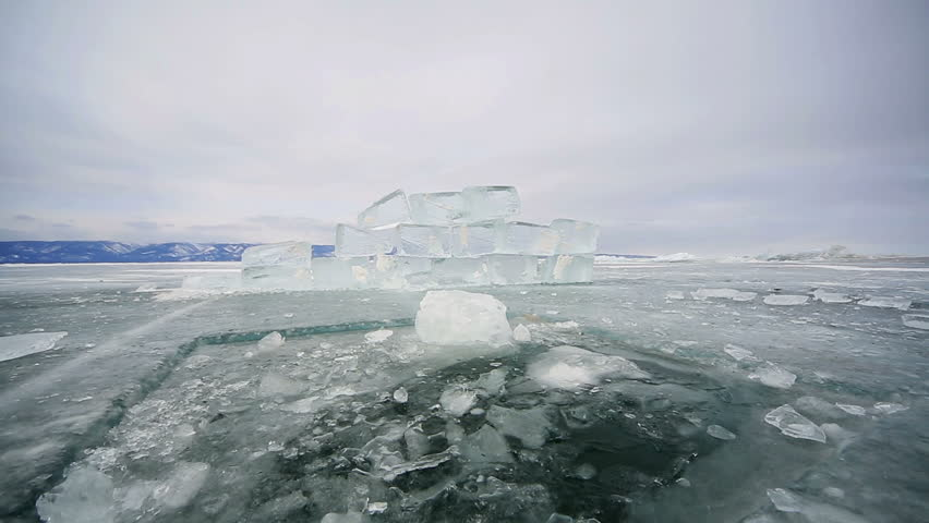 Hole in the ice Baikal ice, icy hole and block | Shutterstock HD Video #9284681