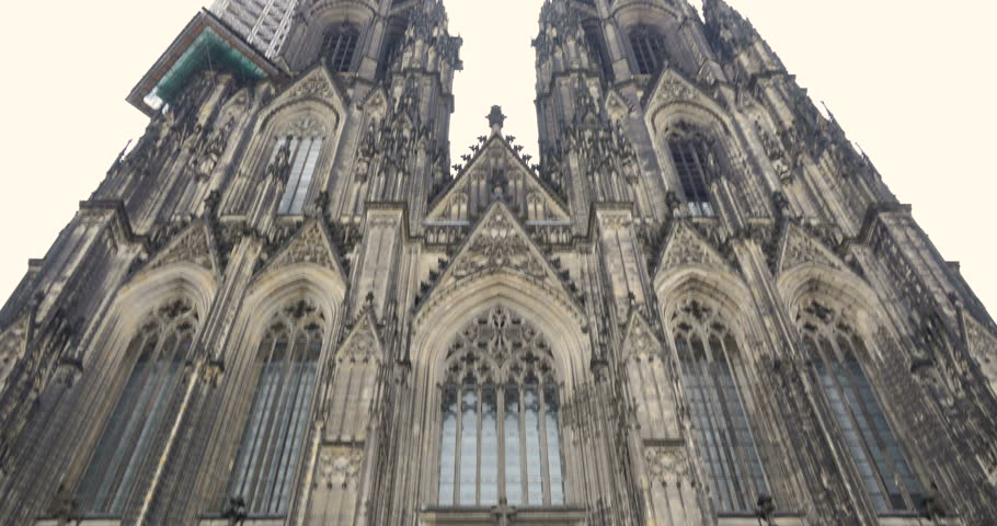 4096x2160 4K pan tilt up camera motion video of Cologne Cathedral (Koelner Dom) - catholic church building in gothic  architecture style in Koln, Germany, Europe, famous medieval religion landmark