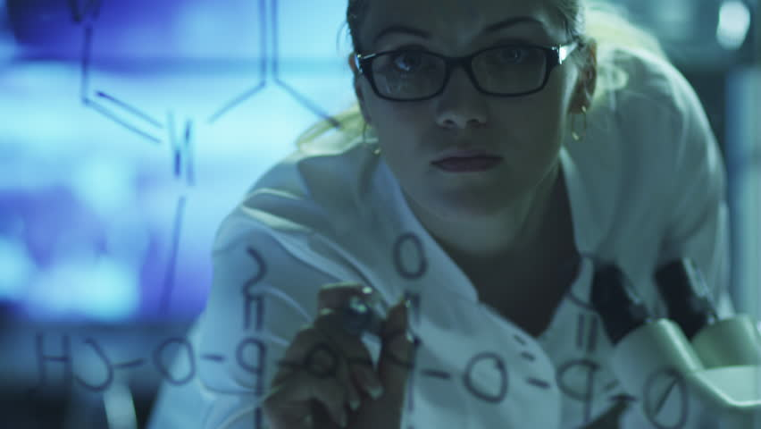 Woman Scientist is Drawing Organic Chemical Formulas on Glass. Shot on RED Cinema Camera in 4K (UHD).   Shutterstock HD Video #9344678
