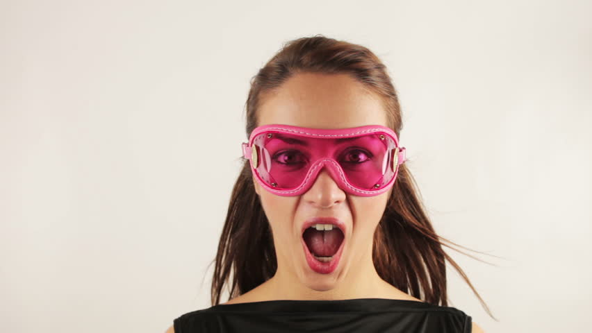 woman wearing cool goggles with air blowing her hair