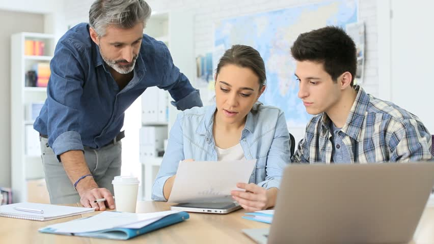 Students with trainer working on project | Shutterstock HD Video #9393671