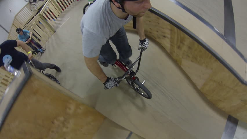 "Ottawa, Canada - March 2015 - BMX riders wearing a unique GoPro mount ride the city's brand new ""Epic Indoor bike park"" on it's opening day. 