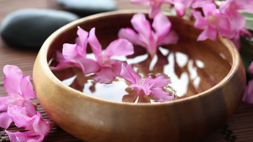 flowers floating in bowl
