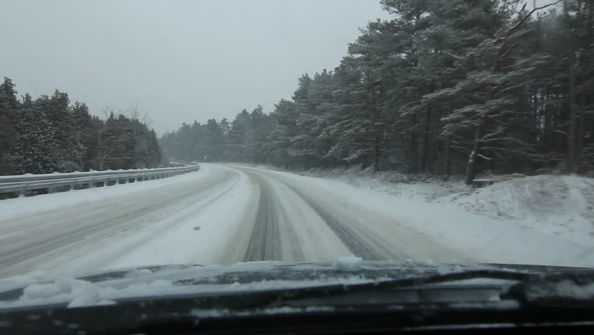 Snowstorm drive in the country. Going around a corner. Driving on Highway 7 just west of Rockwood, Ontario, Canada.   Shutterstock HD Video #9489911