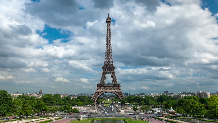 Eiffel Tower in a cloudy day with rushing clouds and busy traffic in Jena Bridge. 4K time lapse of Paris cityscape view from Trocadero Gardens to Avenue de New York   Shutterstock HD Video #9490331