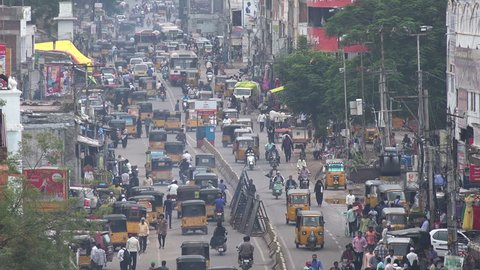 HYDERABAD, INDIA - 15 NOVEMBER 2014: Traffic drives through the busy streets of Hyderabad.