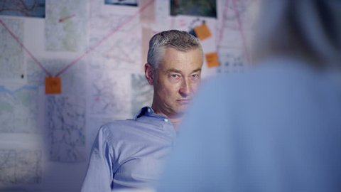 4K Tough female Police Detective interrogating crime suspect in interview room