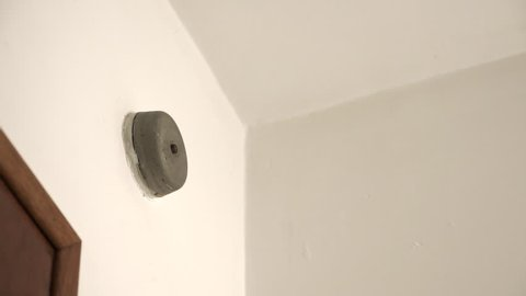 Doorbell chime on white wall ringing.