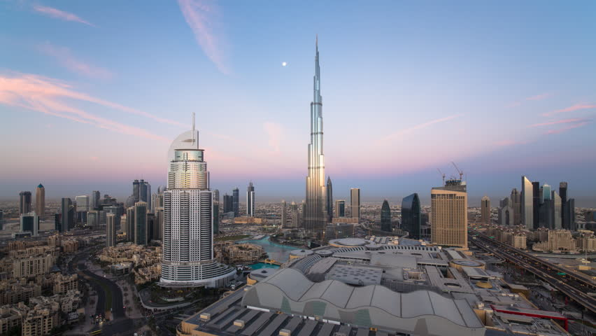 Dubai, United Arab Emirates - CIRCA DECEMBER 2014: The Burj Khalifa, elevated view looking over the Dubai Mall, time-lapse