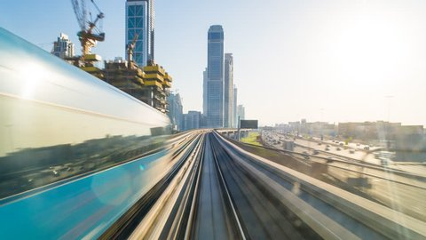 Dubai, UAE - CIRCA DECEMBER 2014: POV time-lapse journey on the driverless elevated Rail Metro System, running alongside the Sheikh Zayed Road