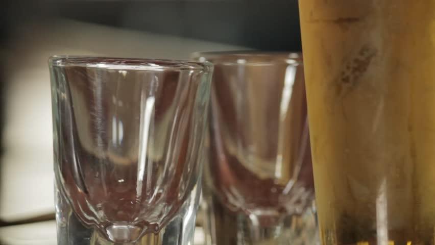 NEW YORK CITY - SEPTEMBER 2014.  Re-enactment, recreation of 1920s to Modern Bar, Booze & Whiskey Bottles, Shots, Alcohol, Liquor during prohibition days. Saloon, Boardwalk Empire. smoking, drinking