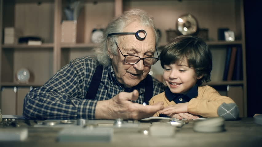 Boy excited with contents of watch mechanics