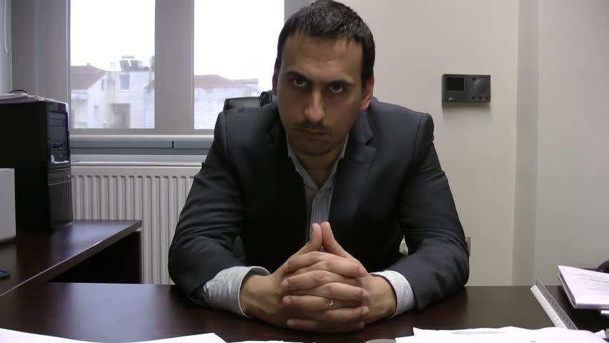 Intimidating man in suit clip