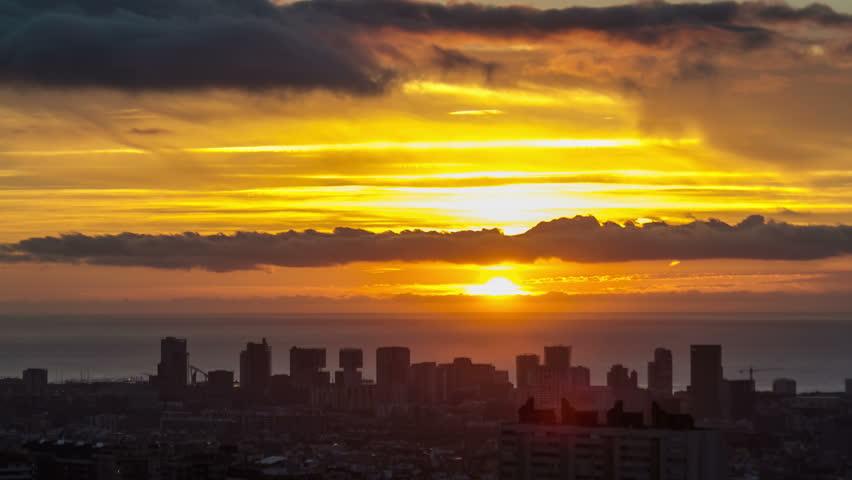 Timelapse (time lapse, time-lapse) of Barcelona city sunrise, Spain.