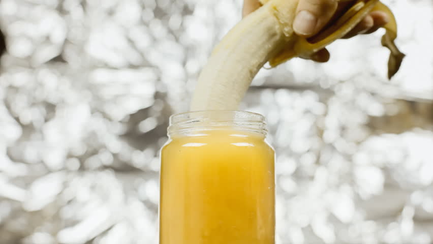 Plunging a peeled banana in a jar of yellow honey. Visual metaphor for a certain type of sexual intercourse: use it when you must visually show but you can't put the real thing.