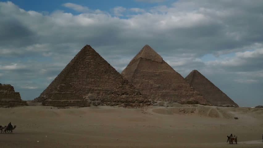 Camels cross in front of the Giza Pyramids on a clear day   Shutterstock HD Video #9681971