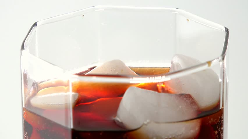 Cola carbonated drink,pop,or softdrink surface featuring ice and bubbles in the liquid | Shutterstock HD Video #9687611