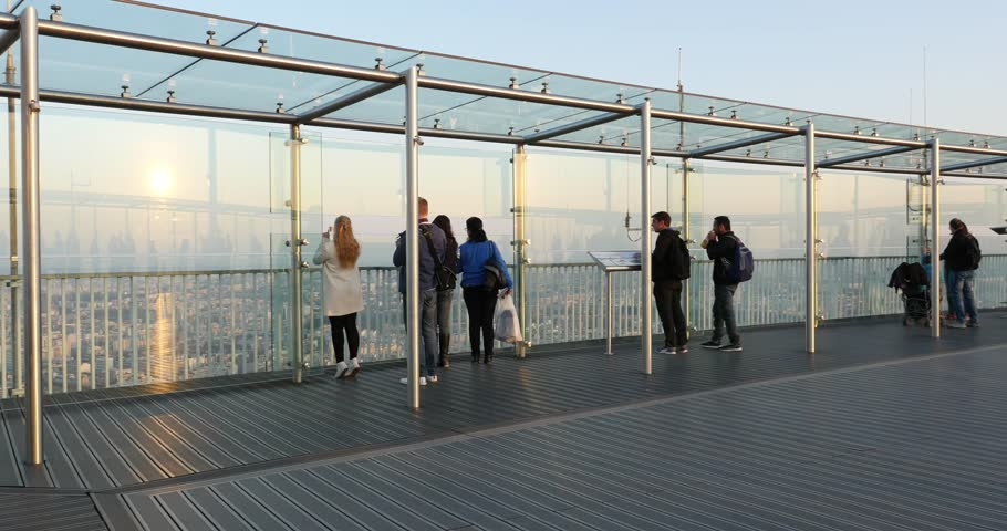 PARIS, FRANCE - APRIL 8, 2015: People on Montparnasse tower observation terrace. Tour Montparnasse is a 210-metre (689 ft) office skyscraper constructed from 1969 to 1973. | Shutterstock HD Video #9700352