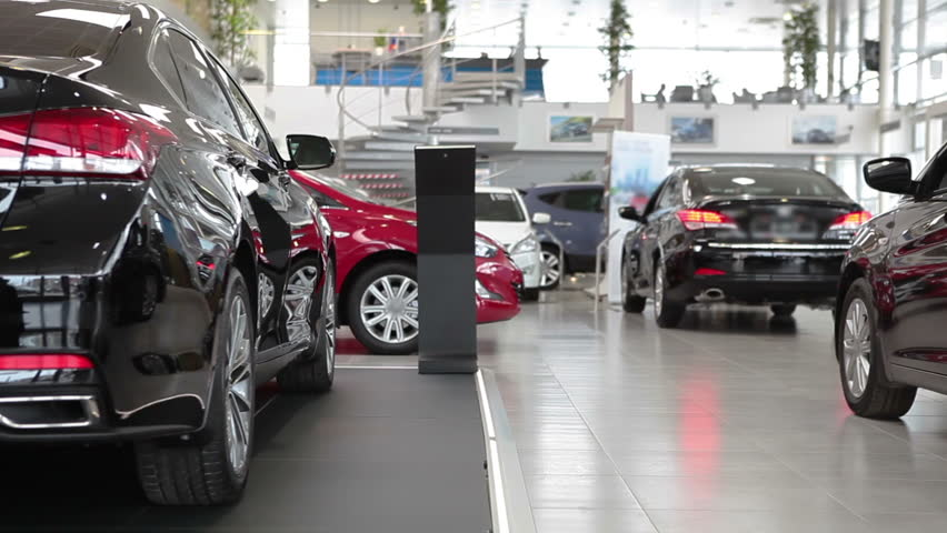 Showroom of auto dealership with luxury vehicles | Shutterstock HD Video #9711935