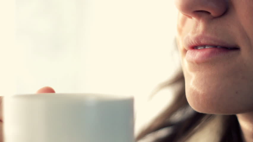 Closeup of female mouth tasting coffee  #973876