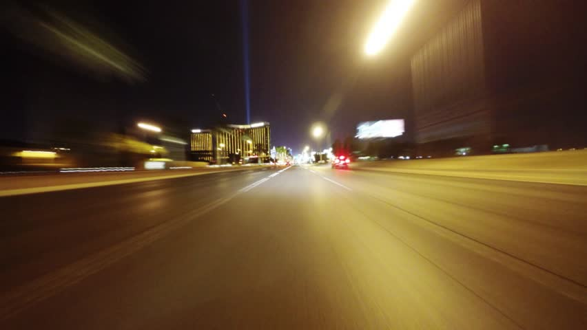 LAS VEGAS, NEVADA, USA - APRIL 11, 2015 (Timelapse): Night shot of Las Vegas Boulevard from the perspective of the front of a moving vehicle. This area is also referred to as The Las Vegas Strip. | Shutterstock HD Video #9769961