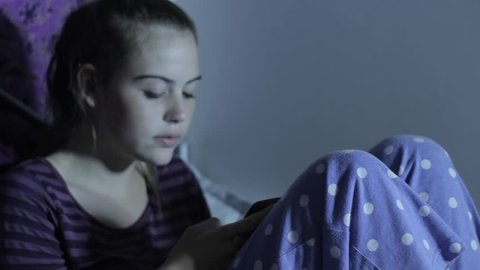Girl On Phone Teen Depression Cyber Bullying and Internet Social Media.