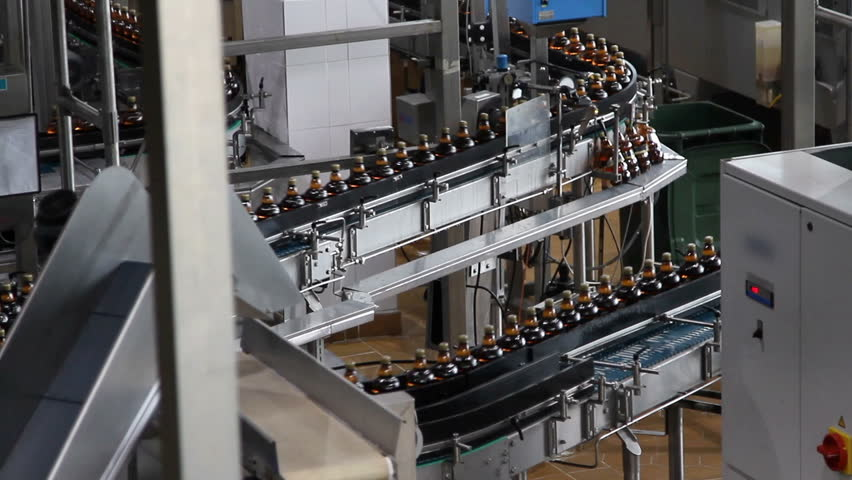 Plastic water bottles on conveyor or water bottling machine    Shutterstock HD Video #9817139