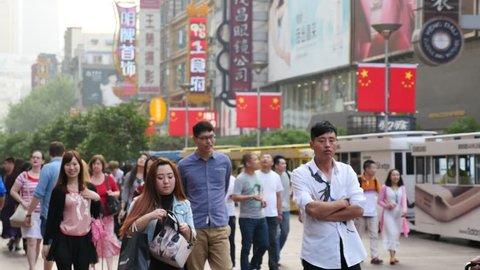 SHANGHAI, CHINA – April 30: Crowded visitors and travelers walking at Shanghai Nanjing Road on April 30, 2015 in Shanghai, China. Nanjing Road is the most famous landmark of Shanghai,China