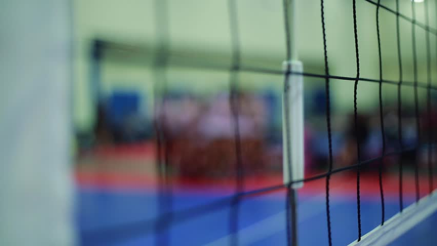 Close-up Pan Shot Of A Volleyball Net At An Indoor Court Stock ...
