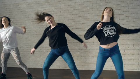 Shaky camera of three girls performing dancehall combination