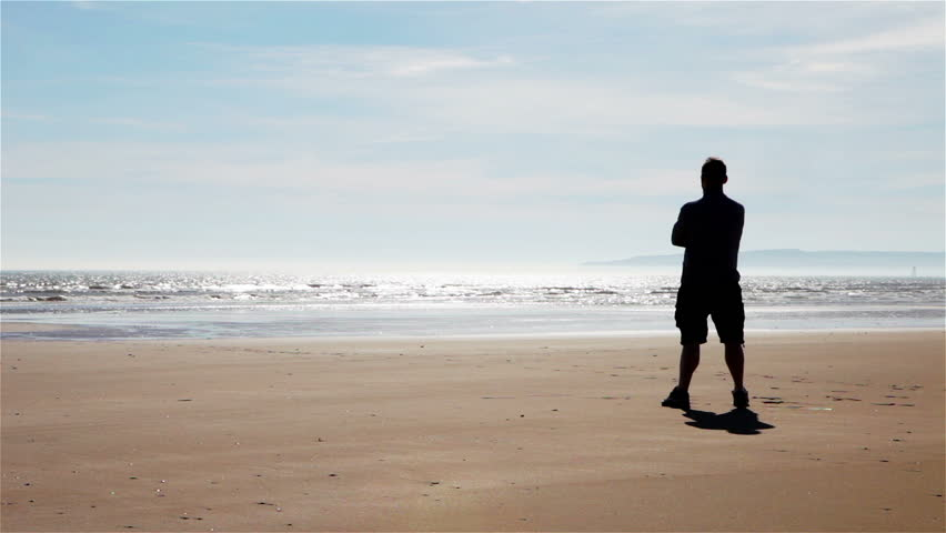 alone man standing on the seashore stock footage video