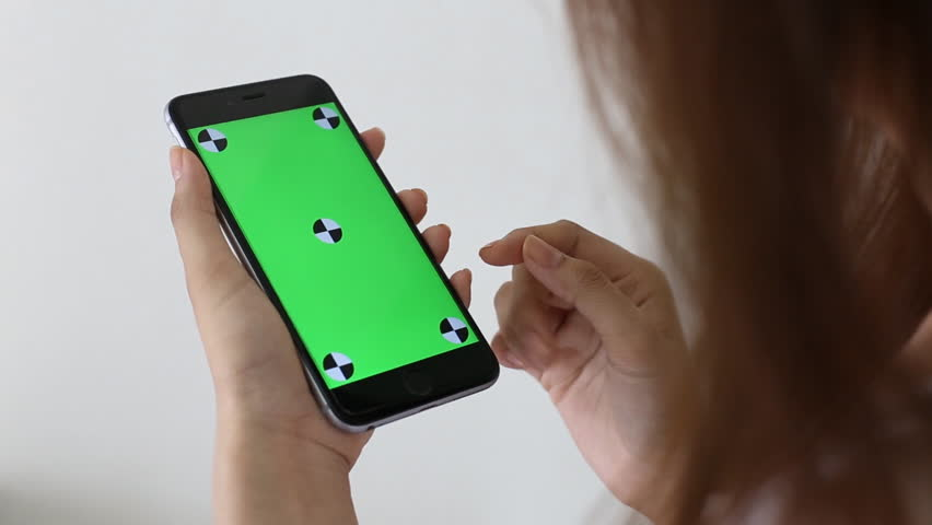 Asian girl touching a smart phone on green screen with marker   Shutterstock HD Video #9928901